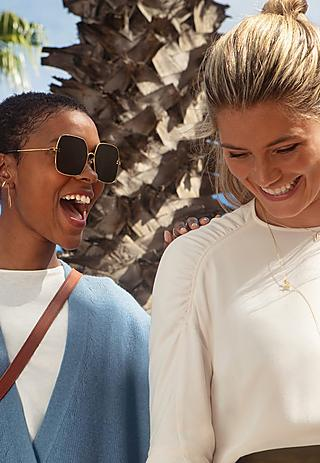 Portrait of two girls laughing wearing Fitflop Shoes
