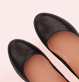 Womens black ballerina flat shoes.
