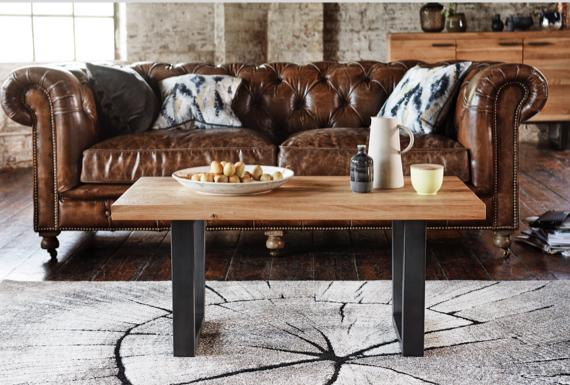 Earth coffee table with Chesterfield sofa.