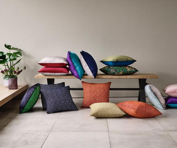 A mixture of colourful Furniture Village cushions.