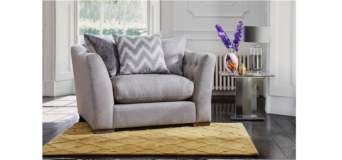 Grey snuggler chair with pillow back cushions