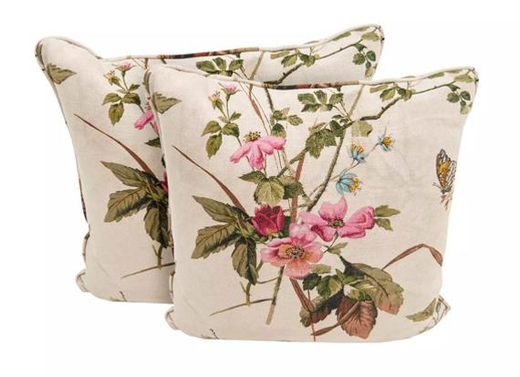 Fabric sofa with green and botanical cushions.