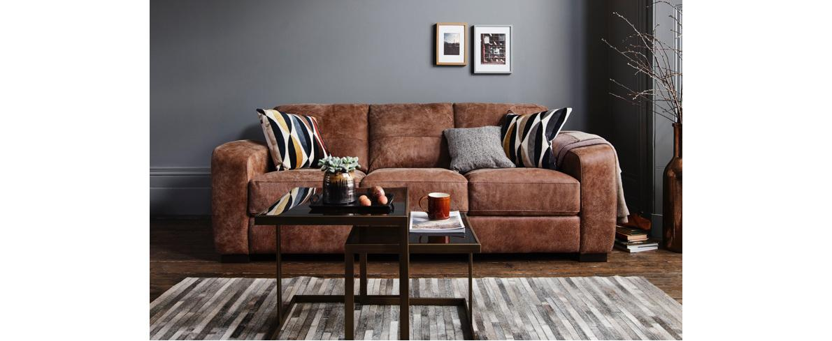 Brown leather sofa with cushions