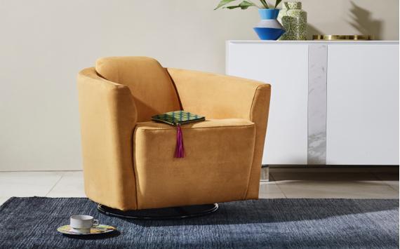 Yellow swivel chair and grey rug