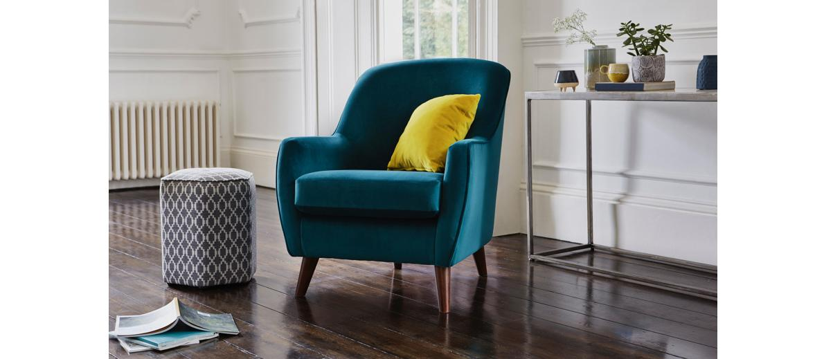 Teal fabric accent chair with yellow cushion