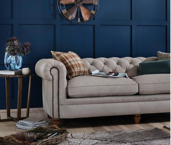 Grey fabric Chesterfield style sofa