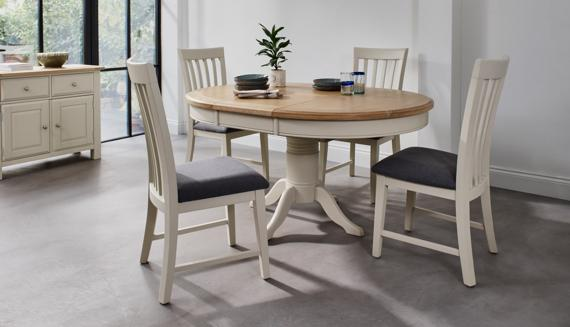 Two tone round extending dining table and chairs