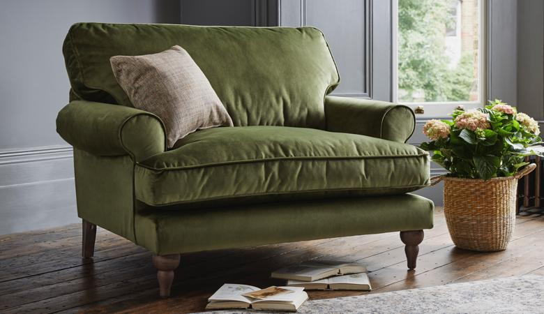 Green velvet chair, pot plant, cushion