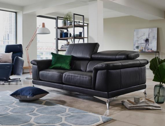 Modern black leather sofa with metal feet