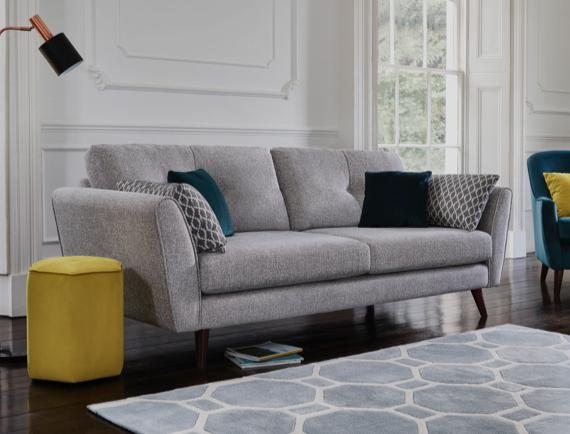 Scandi style grey sofa with bright cushions
