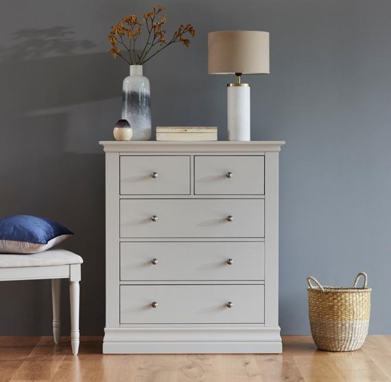 White chest of drawers in grey bedroom