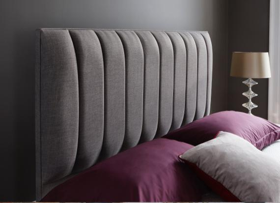 Dove grey bed with fluted headboard