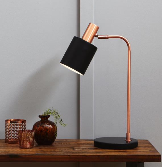 Bedroom colour ideas – black and copper table lamp