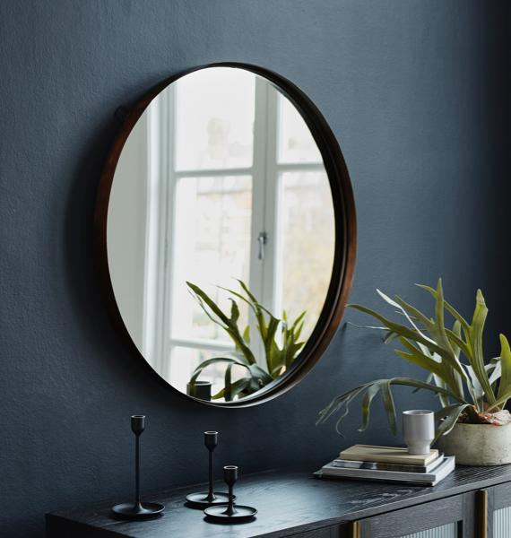 Black bedroom ideas – round metal frame mirror