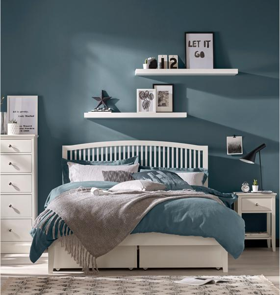 Blue bedroom idea – white slatted bed frame