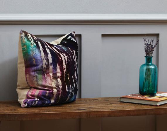 Purple and grey bedroom – multicoloured cushion
