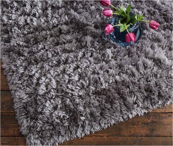 Purple and grey bedroom ideas – large wool rug