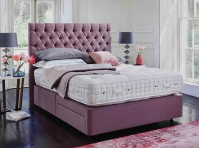 Pink upholstered divan bed