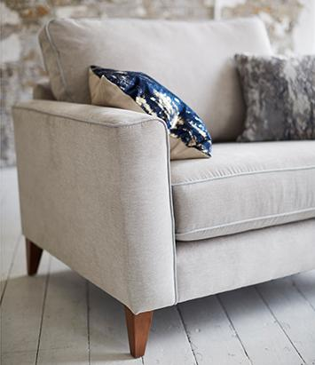 Scandi style cream sofa with abstract cushions