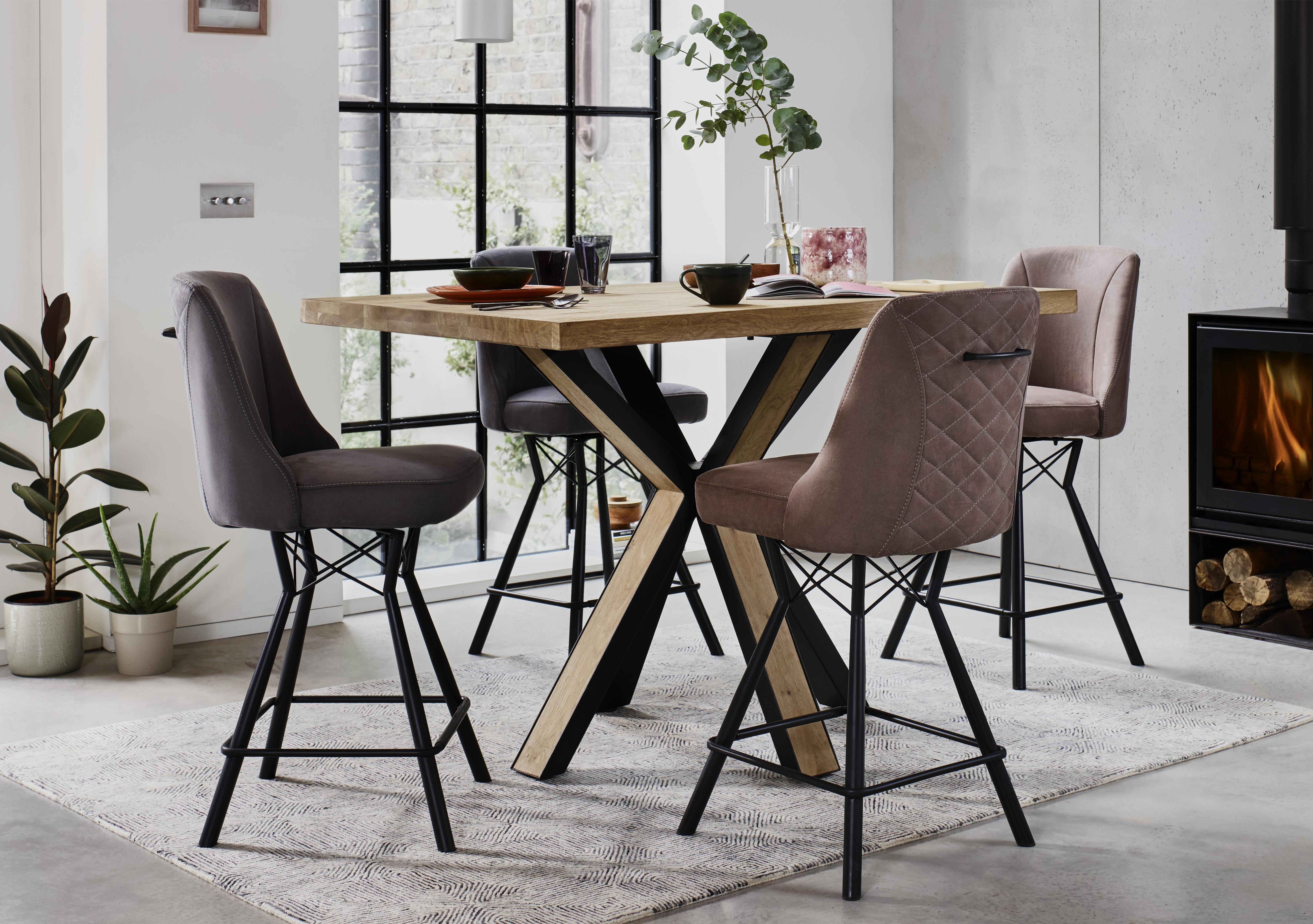 Wooden bar table with upholstered chairs