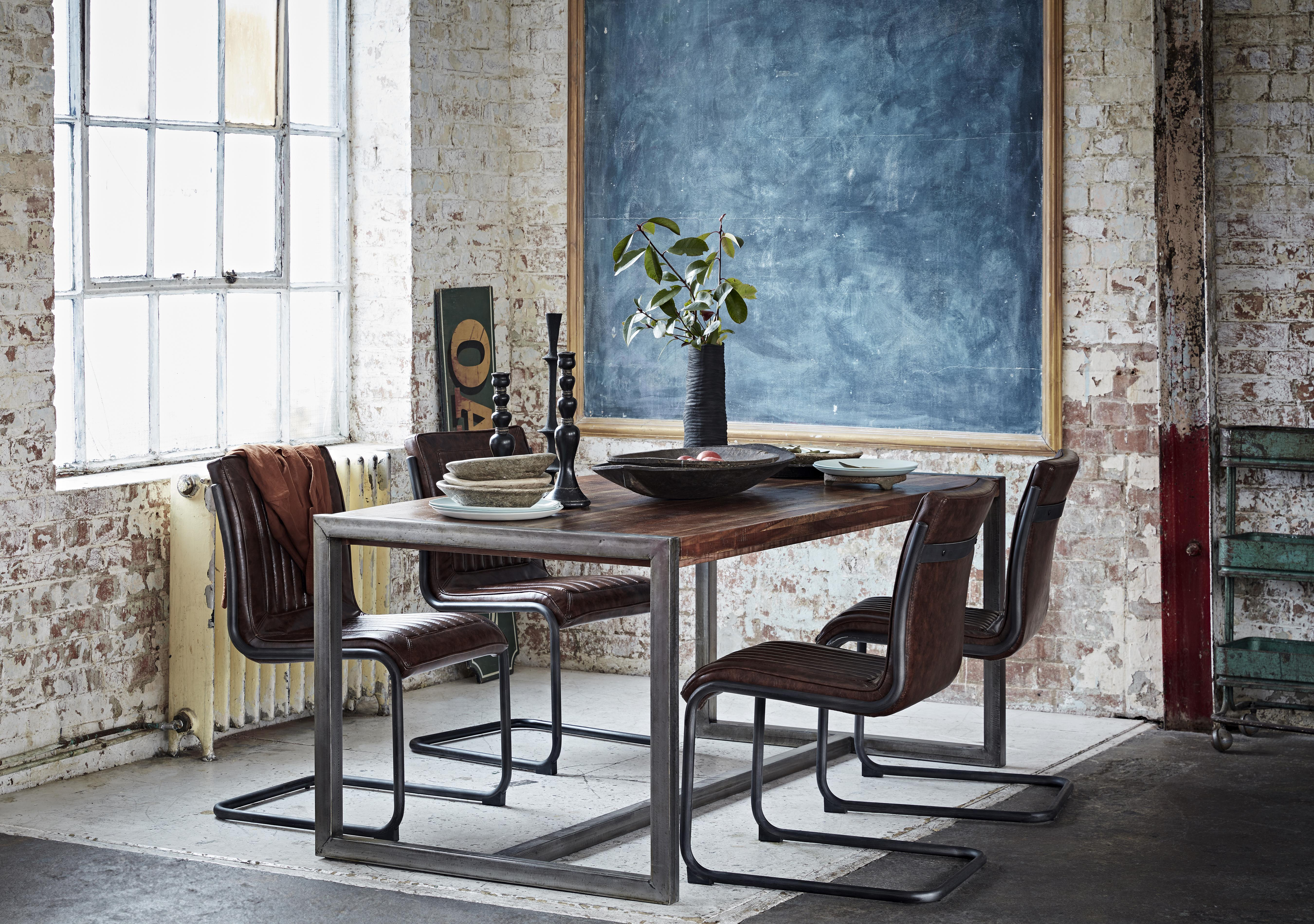 Wooden dining table with upholstered chairs