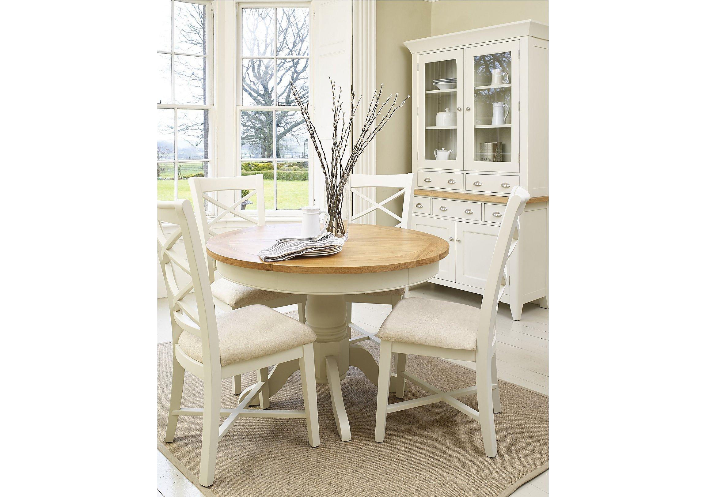 https://i1.adis.ws/i/fv/PRODARLSRDTBDHD-001_arles_round-extending-dining-table__lifestyle?$zoom$&h=1623&w=2304