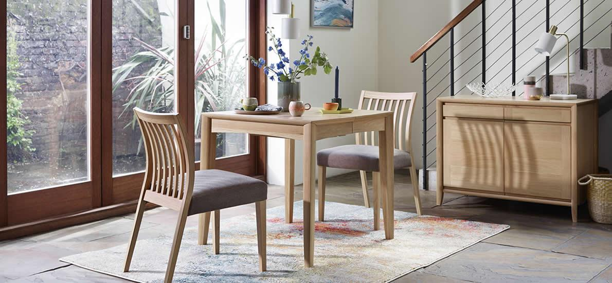 Light oak small dining table with slat back chairs