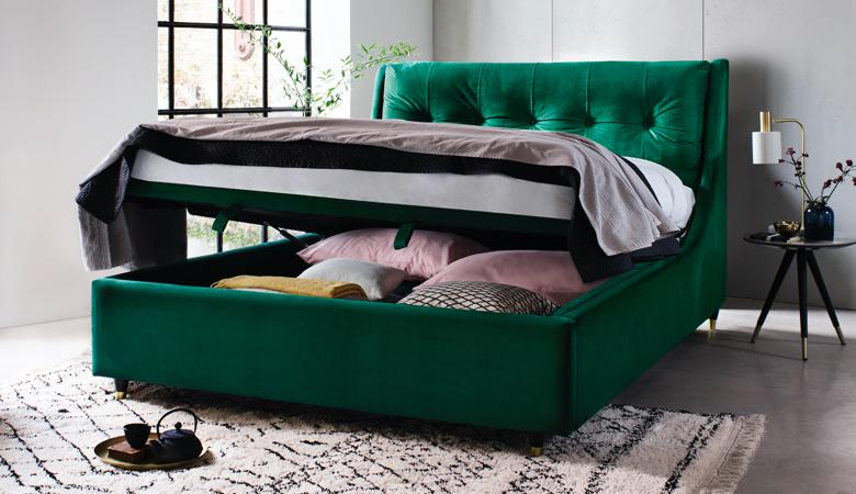 green upholstered ottoman bed