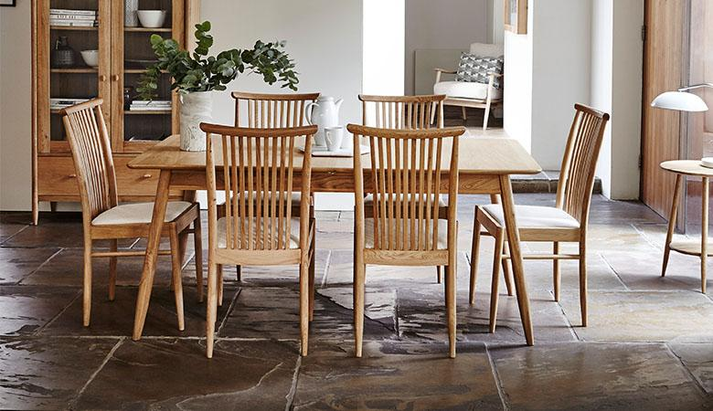 Natural wood dining set with spindle back chairs