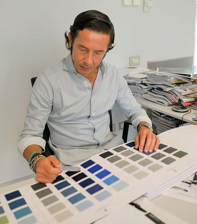 Carlo Di Stefano reviewing the label's many colours