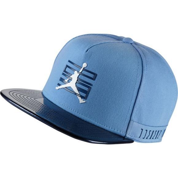 67b7e417bb0 Jordan 11 Light Blue/Navy Snapback Hat - Main Container Image 1