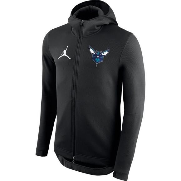 c4fc643616e Nike Men s Charlotte Hornets Showtime Hoodie - Main Container Image 1