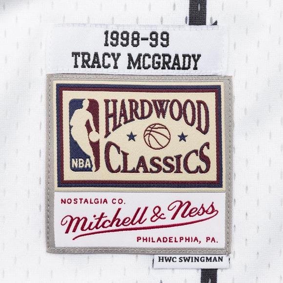 938efa8fba8f Mitchell   Ness Men s Tracy McGrady Toronto Raptors Split Hardwood Classics  Swingman Jersey - Main Container