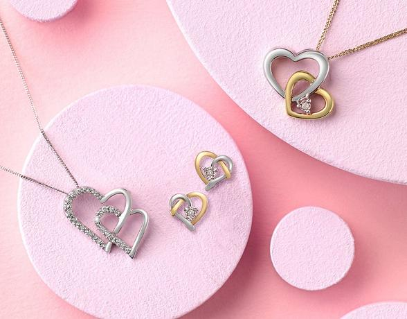 Silver and yellow gold heart pendant and stud earrings