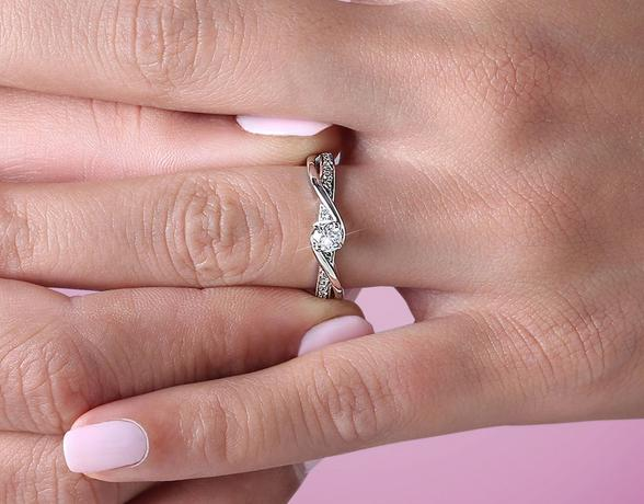 woman wearing diamond engagement ring