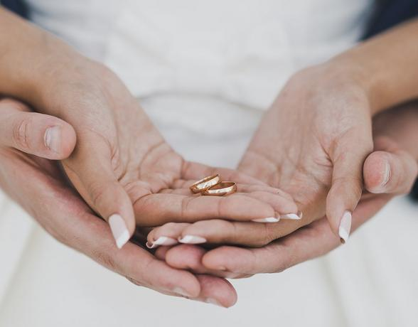 woman holding two wedding rings