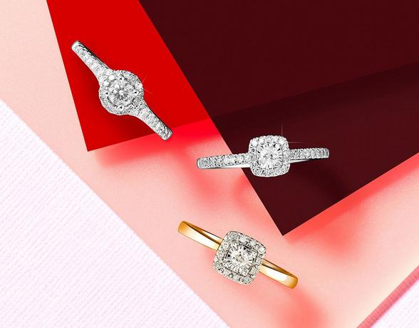 three diamond engagement rings on a red background