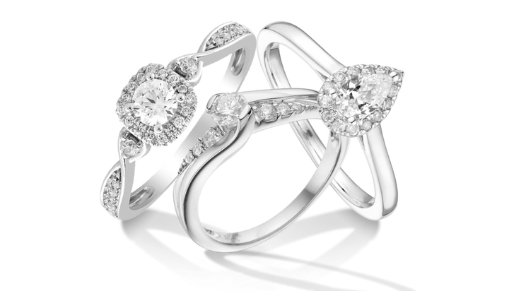 a cluster of three engagement rings