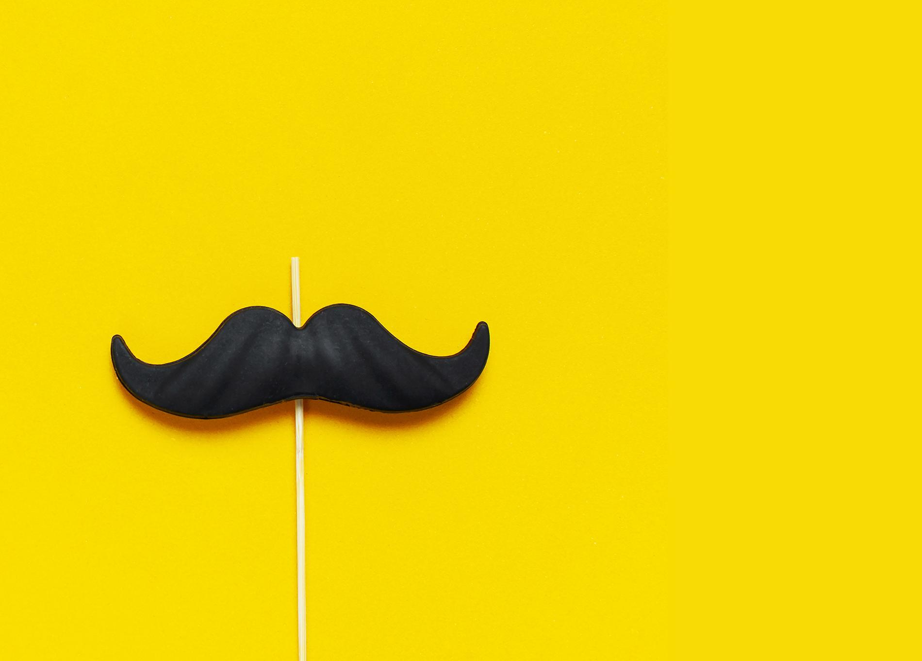 mustache against a yellow background