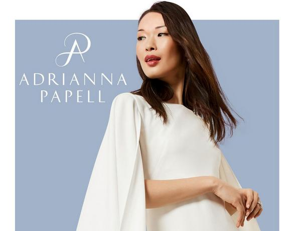 woman posing with adrianna papell logo