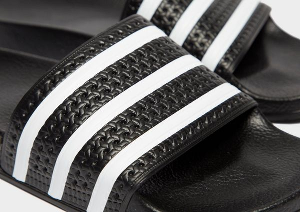 super popular 1b6f5 9c3ba adidas Originals Adilette Slides