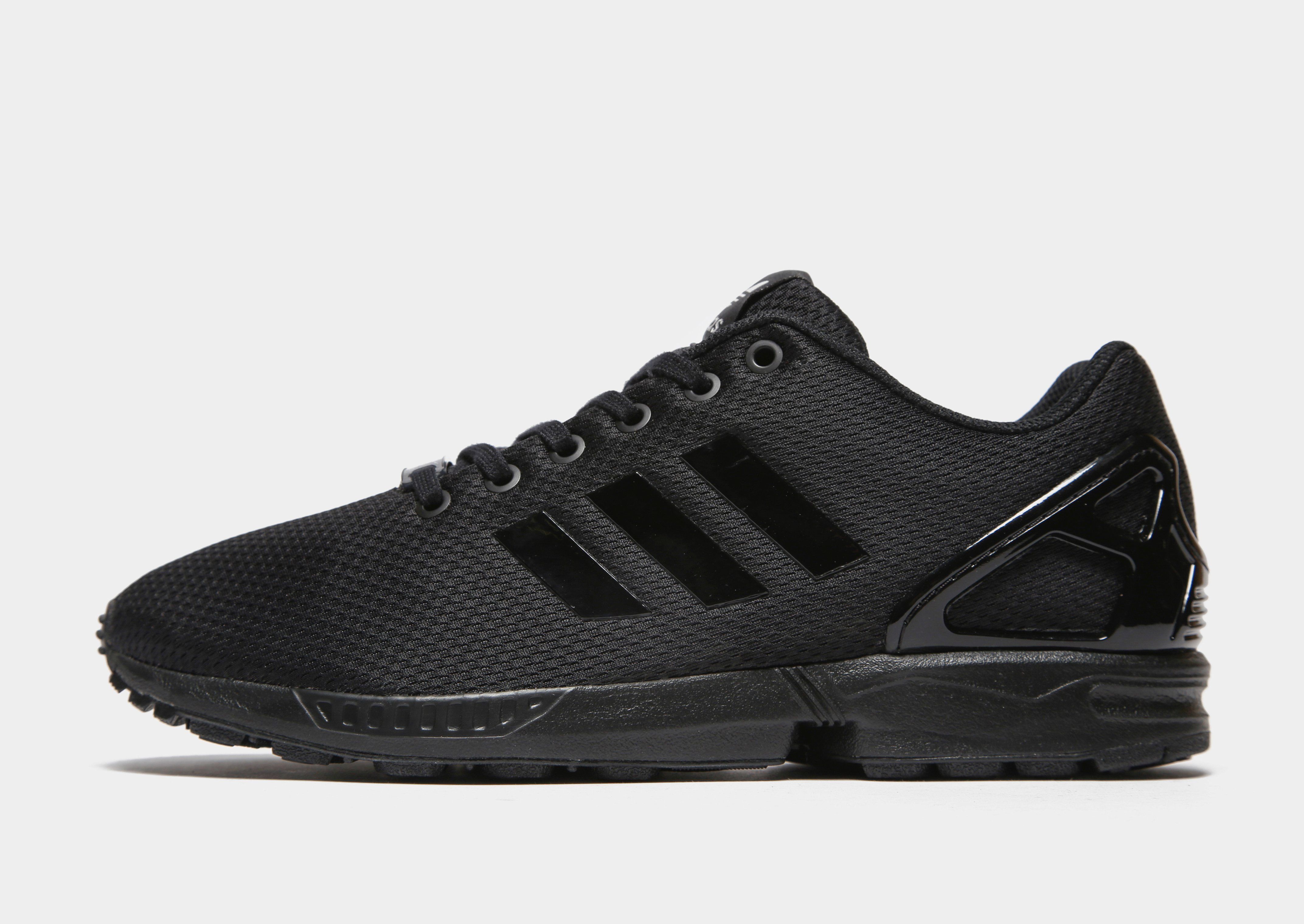 black adidas trainers men