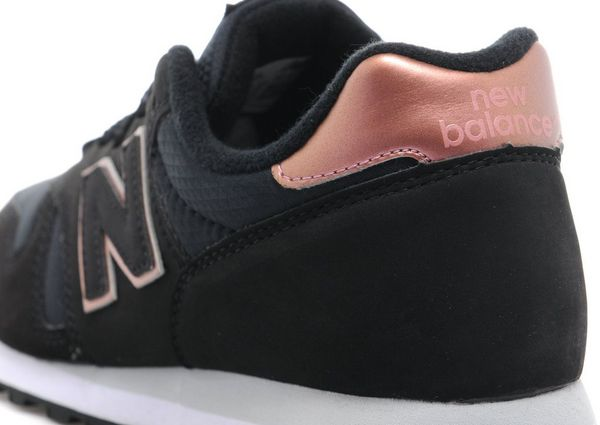 new balance 373 black and gold trainers