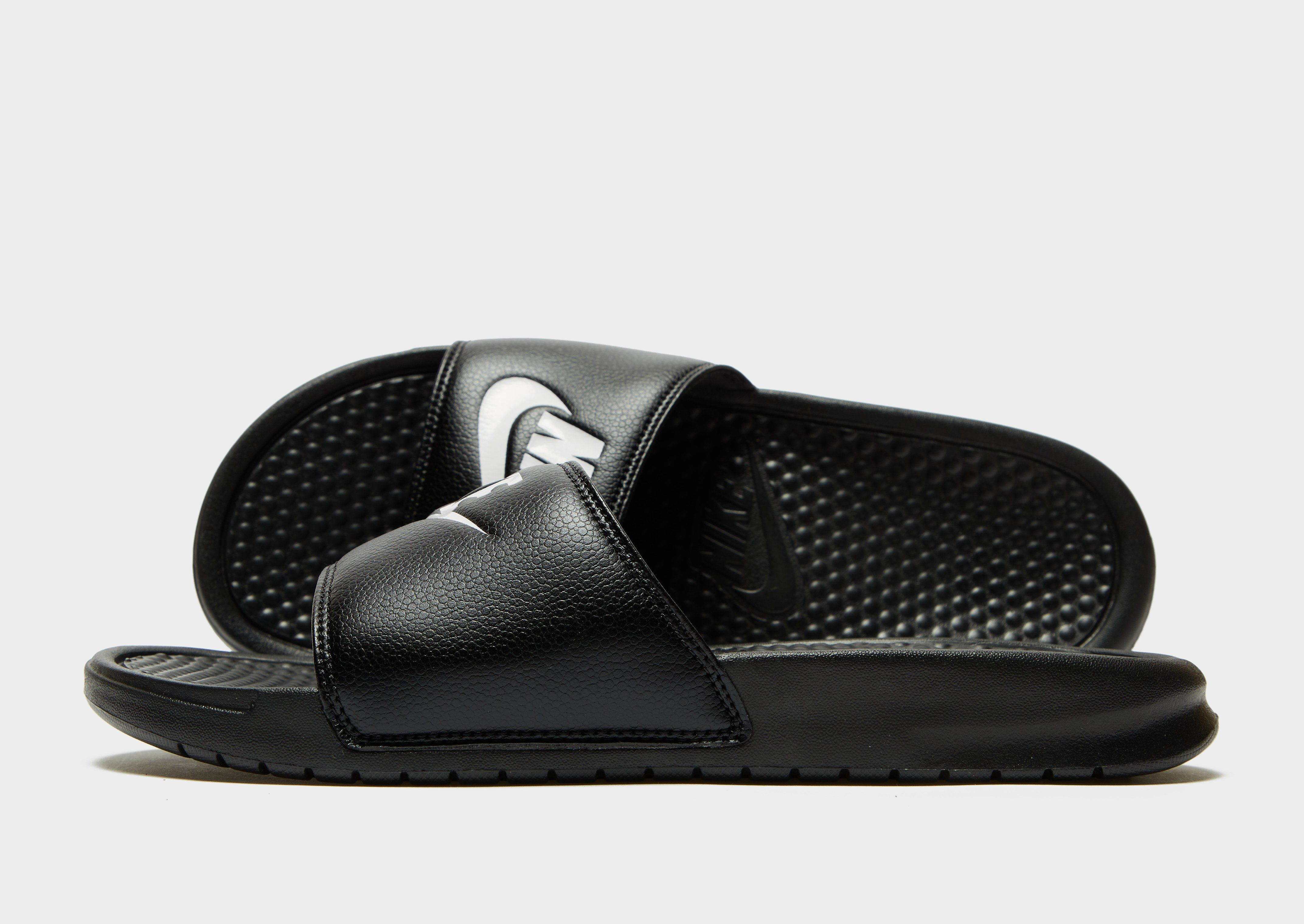 on sale 7af90 856af Nike Benassi Slides ...