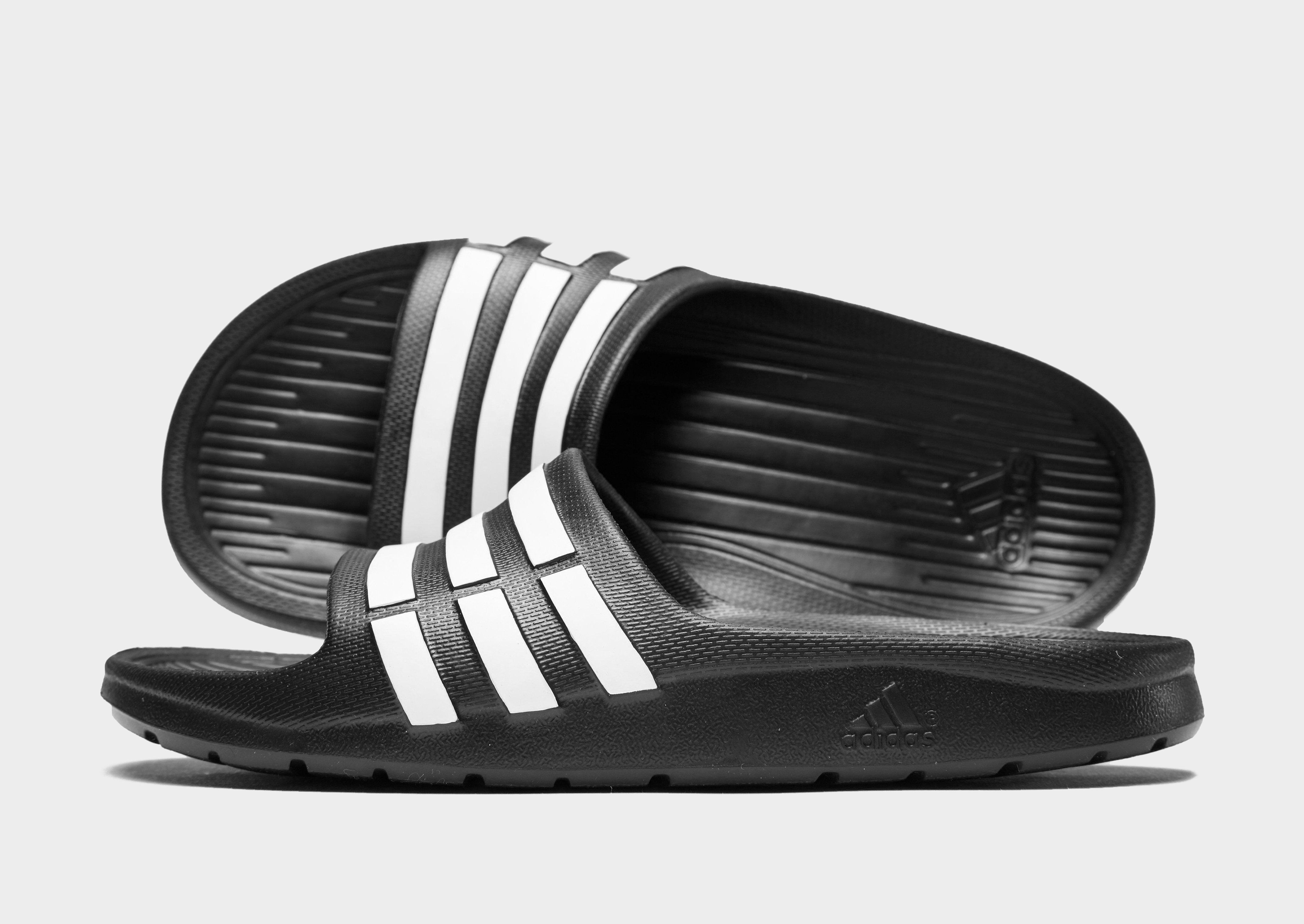 sports shoes c84c8 7c3f5 adidas Duramo Slides Children ...