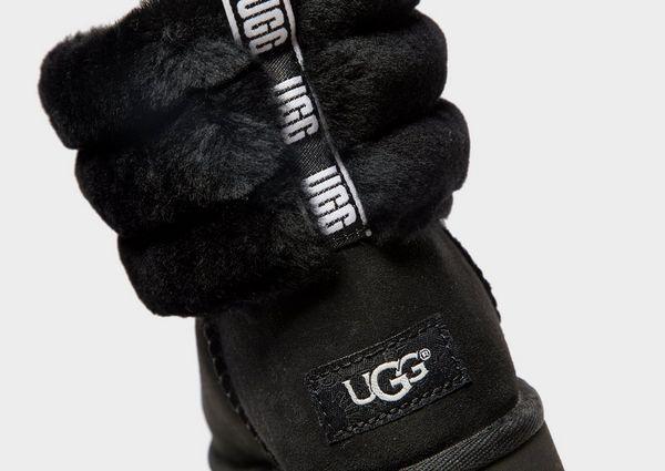 1f56121d3c3d UGG Fluff Mini Quilted Logo Boots Women s
