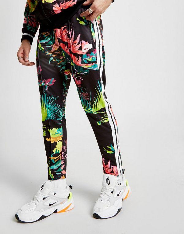 15d72a77b5 Nike Sportswear All Over Print Track Pants
