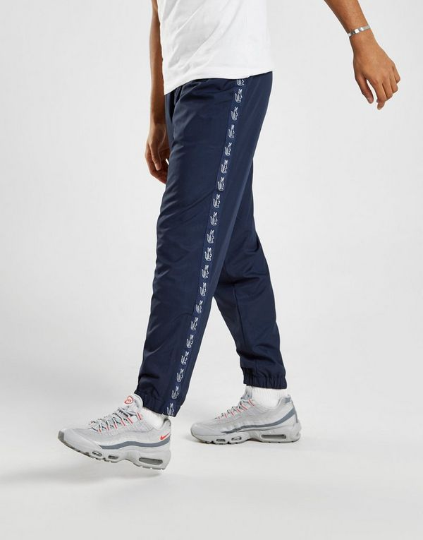 f739f5b8d0 Lacoste Pantalon de survêtement Tape Guppy Homme | JD Sports