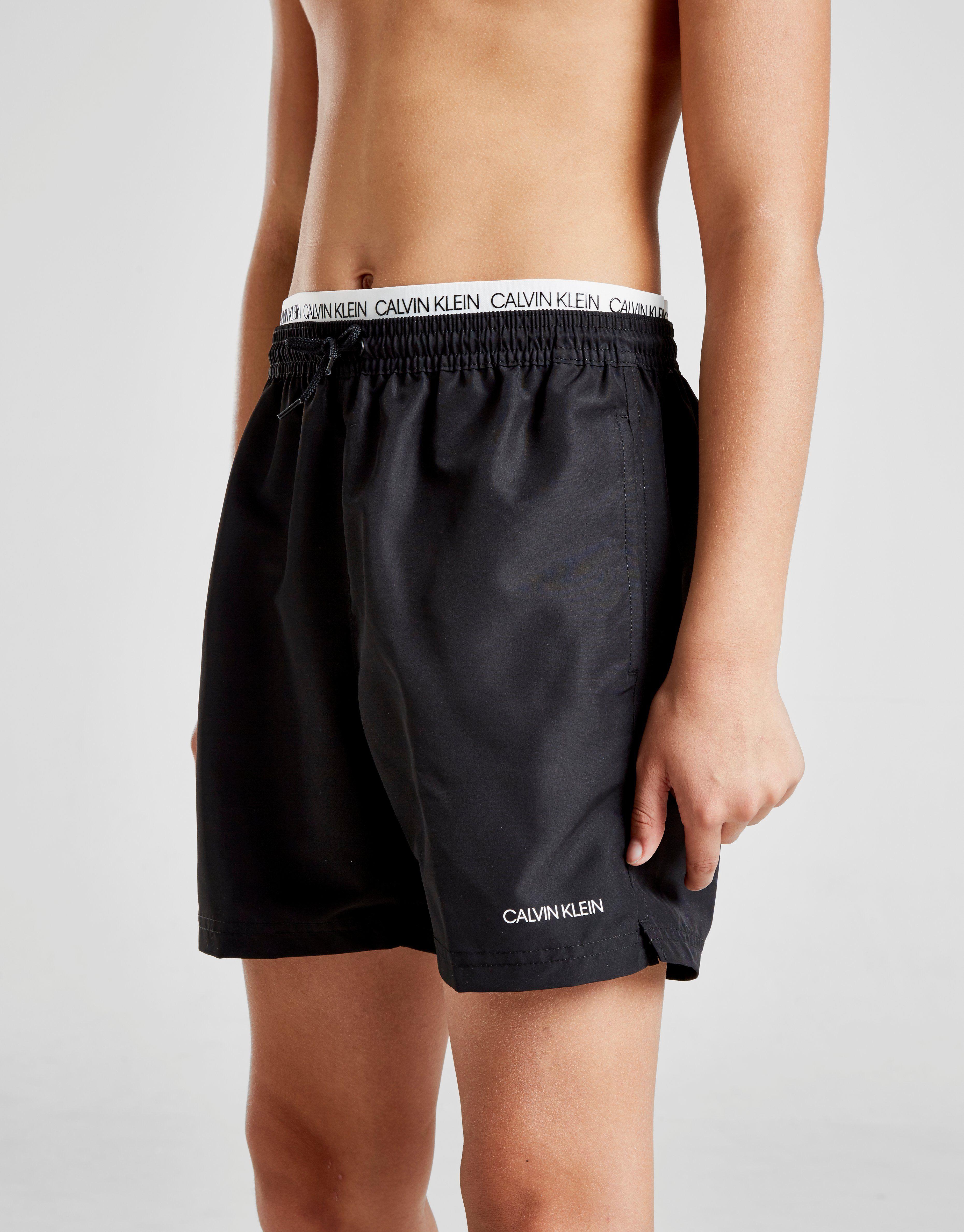 huge discount dfcf2 ebf2d Calvin Klein Waistband Swim Shorts Junior   JD Sports Ireland