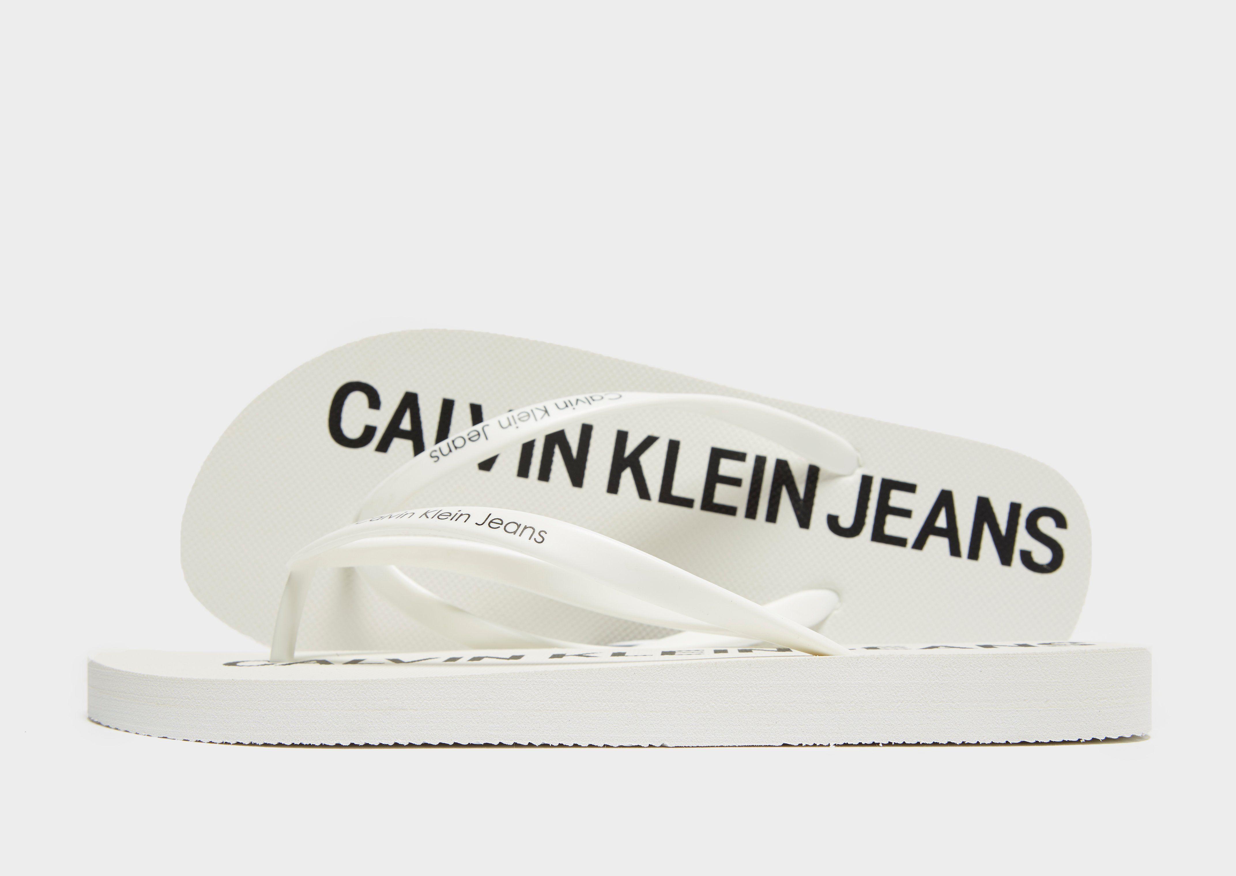 826232966e0e Calvin Klein Jeans Dori Jelly Flip Flops Women s